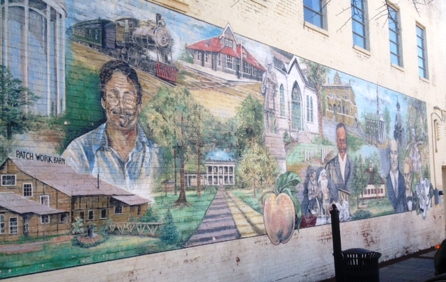 A mural outside Scott's Books featuring prominent Southern authors and buildings