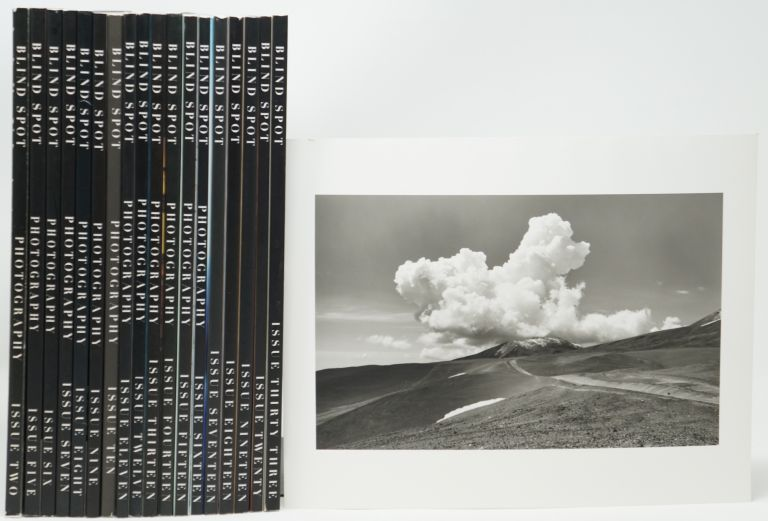 """18 Issues of Blind Spot, Issues 2-20 and 33 with Original signed Alberto Caputo Print [Issues 2, 5, 6, 7, 8, 9, 10, 11, 12, 13, 14, 15, 16, 17, 18, 19, 20, and 33, with Signed Print """"Continental Divide, Argentina,"""" 1992]. Kim Zorn Caputo."""