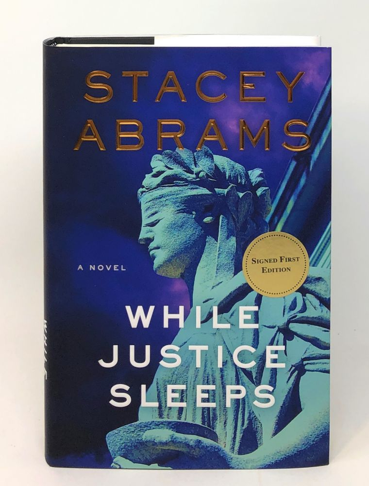 While Justice Sleeps [SIGNED FIRST EDITION]. Stacey Abrams.